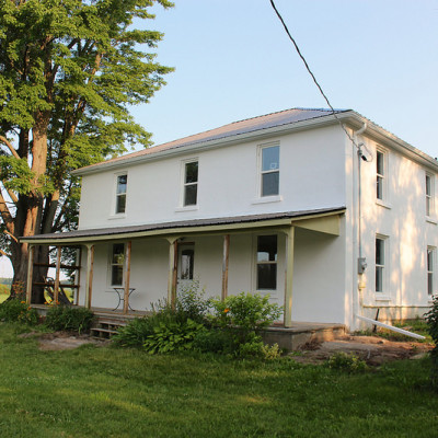 Farmhouse Restoration – Painting Stucco and Windows