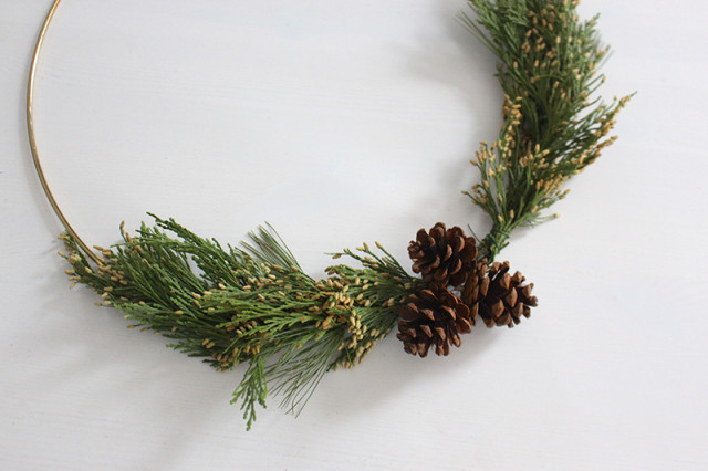 brass-ring-christmas-wreath-pinecones-added