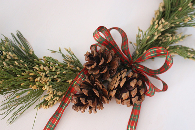 brass-ring-christmas-wreath-pinecones-ribbon