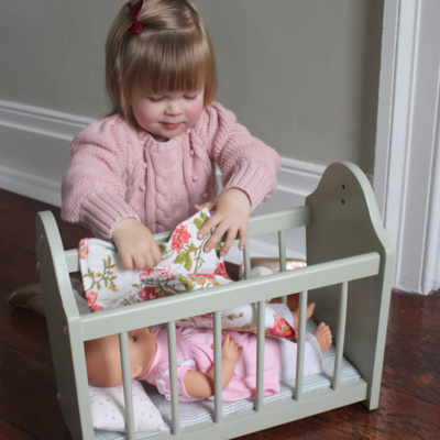 DIY Doll Crib from a Magazine Rack